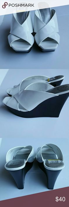 "Jessica Simpson  Platform Sandals  size 8.5 Beautiful  black and white patent leather  wedge  sandals  platform height back 5"" front platform 1 1/2"". Jessica Simpson Shoes Platforms"