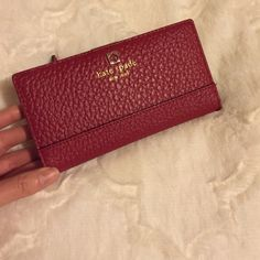 """Adorable kate spade southport avenue Stacy ❤️ NWOT kate spade southport avenue wallet in """"dynasty red"""" color ❤️❤️ 12 credit card slots, 1 I.d. Slot and 4 bill holding slots. 1 zipper pocket in back. Gold hardware. kate spade Bags Clutches & Wristlets"""
