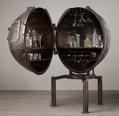 Steampunk Globe Bar Cabinet. Steampunk Decor We Love at Design Connection, Inc. | Kansas City Interior Design http://designconnectioninc.com/blog/ #Steampunk #InteriorDesign