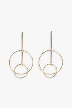 A new take on hoop earrings, these interconnected gold circles give off modern yet tribal feels.