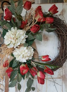 Handmade item  Materials: grapevine wreath, glue, wire, wired burlap, realistic fern, realistic greenery  Made to order Ships from United States  Questions? Contact shop owner Item details BEST SELLER This beautiful tulip hydrangea burlap front door wreath is the perfect simple accent for your door or interior. A wired burlap ribbon makes a simple bow. FRONT DOOR WREATH  Average Diameter: 22 (tip to tip) This wreath will be created on a grapevine wreath measuring approximately 18 Indoor…