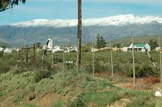 The beutiful town of McGregor with snow on the mountains, Western Cape, RSA, Aug 2013