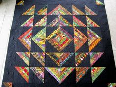 """This quilt is called """"Westminster Roman Stripes"""". The colors are so saturated and rich! The light area is quilted with flowers and the d..."""