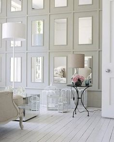 You could do a wall of mirrors pretty affordably - they sell full-length plastic mirrors at target or walmart for about five dollars, and you could hang them up and put some trim on the wall to create those rectangles and paint it all the same color.