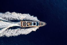 Azimut presents the new Azimut - a carbon-fiber motor yacht with a top speed of 35 knots. Azimut Yachts, Motor Yacht, Carbon Fiber, Boats, Top, Ships, Crop Shirt, Boat, Shirts