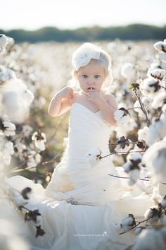 Baby in Moms Wedding Dress. Sooo cute! I want to do this if I ever have a little girl.