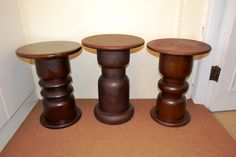 Three hand turned, solid wood side tables.