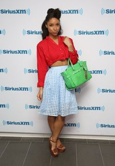 Pin for Later: Lianne La Havas's Style Is Unstoppably Cool Visiting the SiriusXM Studios, Lianne contrasted her vintage cropped jacket with sheer checked skirt and an eye-popping green bag.