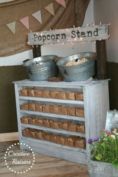 Creative Raisins: Shabby Chic Wedding ~ Popcorn Stand. Love the idea of putting food on top and serving dishes/trays/bags inside a cabinet..