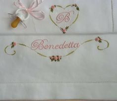 Elizabeth Hand Embroidery: Getting ready for the Blessed ...Sheet set for baby. The font used for the name is, once again, the 'Edwardian Script and is embroidered with two strands of MULINE in a much paler shade of pink in the photo, the DMC 963. Colors of the vine and the roses are the 3716, the 734, the 732, the 963 and the 725, always DMC.