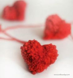 Learn How to Make a Pom Pom Heart this Valentine's Day and turn them into garlands and other precious decorations!