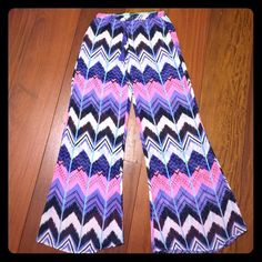 Surf Gypsy Swim Cover Up Mesh Pant Beautiful geometric pattern swim pant coverup. Brightly colored in hues of pink, purple, sky blue, black and white. Bought to wear in Hawaii but never got the chance. Says a medium but runs small. 100% polyester Surf Gypsy Jackets & Coats