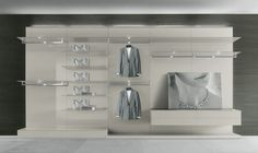walk-in wardrobe with panels, bases and hanging drawers in lino colour lacquered glass, shelves in opaque lacquered lino colour.