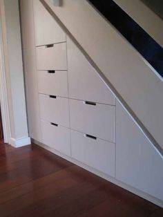 white under stair stringer storage. nice skirt