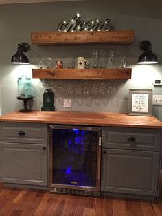 rustic bar with ikea cabinets and beverage center basement bar do Basement Renovations, Home Remodeling, Attic Renovation, Kitchen Remodeling, Casa Santa Rita, Canto Bar, Basement Bar Designs, Basement Ideas, Rustic Basement Bar