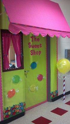Candy shop teacher door. Ikea kids plates covered in clear wrap. Punch balloon wraped in clear wrap super glued to clear wrap roll and wraped with ribbon.
