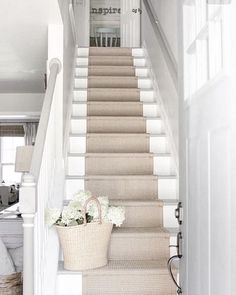 White traditional country staircase with natural jute runner via Oliviagrace