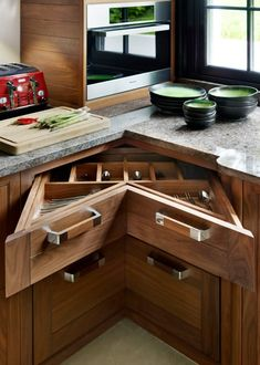 Merging two drawers in the corner of your kitchen a corner in the kitchen with two opposing cabinets can create enough space  to store cutlery. In addition, triangular shapes with handles makes decorating corners an easy task.