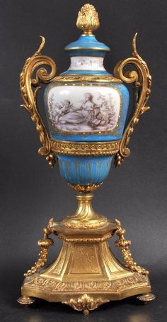 A 19TH CENTURY PARIS PORCELAIN SEVRES STYLE BRASS AND GULT METAL MOUNTED VASE