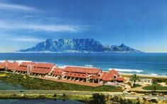 The Dolphin Beach Hotel is on the Cape Town side of Blouberg beach on the winding Cape West Coast. This area boasts some of the longest, most unspoilt beaches in the Cape and is a haven for windsurfers and kite-boarders. Table Mountain Cape Town, Clifton Beach, Cape Town Hotels, Facing The Sun, Beaches In The World, Beach Hotels, Dolphins, West Coast, South Africa