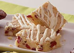 White Chocolate-Cranberry Bars. Stir up cake mix and four ingredients to create a scrumptious cookie bar.