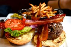 Boyden Farm Vermont All Natural Burger with Applewood Smoked Bacon, Hand Cut French Fries, Housemade Zucchini & Red Onion Pickles on a Brioche Bun @DineAtHarvest in Cambridge, MA