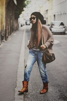 Dian Pelangi Style...thats how u rock boots, torn jeans and hijab...kudos dian