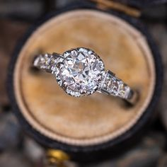 This gorgeous vintage engagement ring features a carat old European cut center diamond grading H in color and in clarity. We love the buttercup setting and beautiful detail work, in addition to the magnificent center stone. This ring is currently Filigree Engagement Ring, Dream Engagement Rings, Antique Engagement Rings, Antique Diamond Rings, Vintage Diamond, Vintage Rings, Vintage Art, Thing 1, Sapphire Jewelry