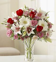 vase of white and red flowers #centerpiece