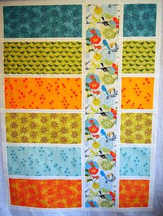Color block quilt. Love the way the vertical strip ties all the horizontal colors together.