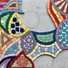 #wip #workinprogress - what do you think of my #funky #colourful #mosaic paving stone so far?