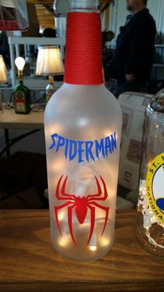 Upcycled frosted and lighted wine bottle with Spiderman decorations A standard strand of 20 white lights are included. Great gift! If your favorite super hero is not listed, let us know! We make custo