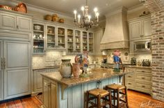 Love the reclaimed wood island top, copper vent hood, lights, cabinets...well, just about everything