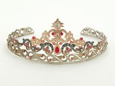 Ruby, Sapphire, Diamond, Silver and 14K Gold Tiara  1 ruby weighing approx 1.70 cts, 80 rubies total approx 5.35 cts, 44 sapphires total approx 1.75 cts, 130 diamonds total approx 1.75 cts, bearing spurious Fabergé marks