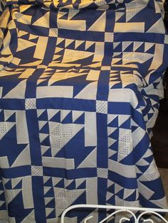 Love, love baskets and 2 color quilts.