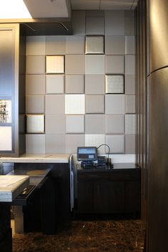 "Adds depth to any corporate space.  Even better, they're ""Peel & Stick"" tiles.  Imagine that! www.nappatile.com"