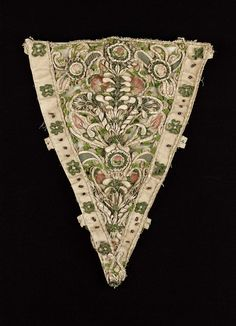 Stomacher | Museum of Fine Arts, Boston.  Relief embroidery of silk floral motifs in pinks and greens on white silk cutwork over wire foundation; green and white fly fringe, chenille and covered wire trim. Silk panels at sides decorated with green silk-covered wire flowers, purple foil and beads.