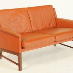 A compact and rather smart sofa by Kai Lyngfeldt-larsen. Solid Brazilian…
