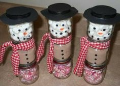 Baby food jars.  From bottom to top: peppermint candies, instant coca, mini marshmallows.  Add scarf, top with hat....