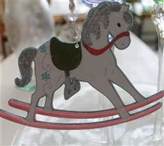This sweet little rocking horse is a double-sided ornament that is sure to beauty up your Christmas tree. It's hanger is made with sparkly crystal beads, so no need to pack it away after the holiday season. Find a sunny window to hang it in and enjoy it for months to come. This keepsake would be great anytime gift. By Lilygirl