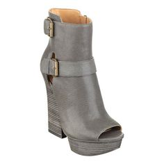 """Style, comfort and a flicker of intrigue. What more could you ask for in a pair of platform booties? (Take a look at the price.) Our Heymama platform booties are definitely a must-have. Peep-toe platform dual-buckle detailing. Side zipper. Leather upper. Man-made sole. Imported.1 1/2"""" platform. 5 1/4"""" stacked heels. Booties. Ankle boots."""