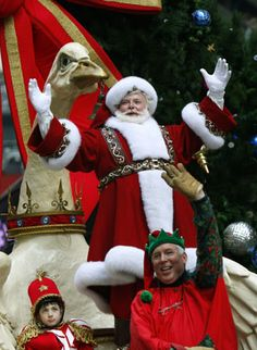 Santa Claus waves to the crowd as he rides aboard his float through Times Square during the Macy's Thanksgiving Day Parade in New York, November 22, 2007.