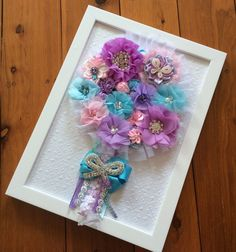 Beautiful everlasting bouquets designed with fabric flowers and quality embellishments :) Available to order at Facebook.com/SmudgeCreativeDesign Fabric Flowers, Bouquets, Embellishments, Facebook, Frame, Beautiful, Design, Home Decor, Ornaments