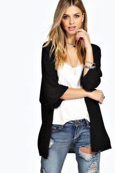 Stay snug and stylish with a cozy cardigan sweater.