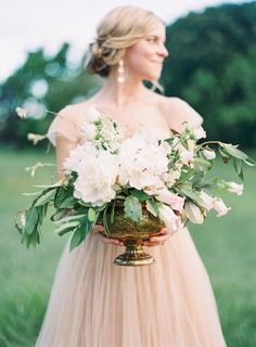 I'd love to see us incorporate some gold antique vases and arrangements like this on detail tables (like escort cards, or something).  Beautiful white floral arrangement in an antique gold urn. #wedding #flowers #centerpiece