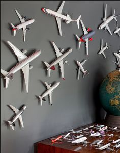 I think this would be a great way to display JBs model airplanes on your navy entry wall.