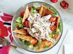 Greek-Style Chicken Salad   This Greek-style main dish salad features parsley salad topped with homemade chicken salad and pita chips.