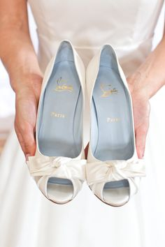 Satiny white Louboutins. Photography by photographybycatherine.co.uk, Event + Floral Design + Planning by byappointmentonlydesign.com, Read more - http://www.stylemepretty.com/2013/06/19/cotswold-england-wedding-from-catherine-mead-photography/