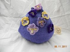 hand knitted pansy tea cosy