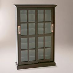A rich espresso finish enhances the handsome look of our Sliding Door Media Cabinet. Each glass-paned door slides open to reveal a spacious and versatile interior, perfect for displaying DVDs, CDs, video games, collectibles and more. While the top and center shelves are fixed, five adjustable shelves combine to create unlimited storage options.